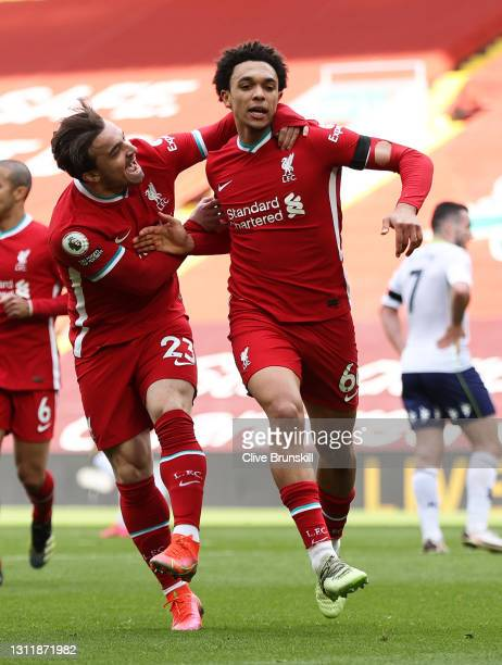 Trent Alexander-Arnold of Liverpool celebrates with teammate Xherdan Shaqiri after scoring their team's second goal during the Premier League match...