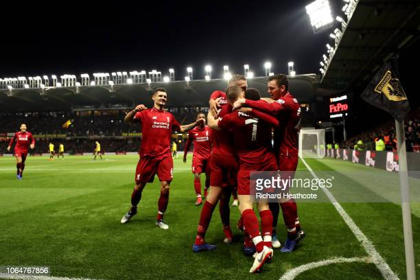 Trent AlexanderArnold of Liverpool celebrates with teammates after scoring his team's second goal during the Premier League match between Watford FC...