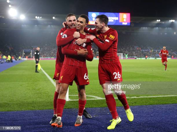 Trent Alexander-Arnold of Liverpool celebrates with teammates after scoring his team's fourth goal during the Premier League match between Leicester...