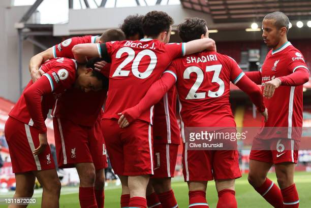 Trent Alexander-Arnold of Liverpool celebrates with teammates after scoring their team's second goalduring the Premier League match between Liverpool...
