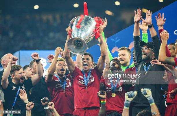 Trent AlexanderArnold of Liverpool celebrates with the trophy during the UEFA Champions League Final between Tottenham Hotspur and Liverpool at...