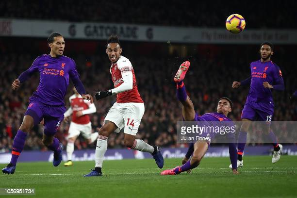 Trent AlexanderArnold of Liverpool clears the ball during the Premier League match between Arsenal FC and Liverpool FC at Emirates Stadium on...