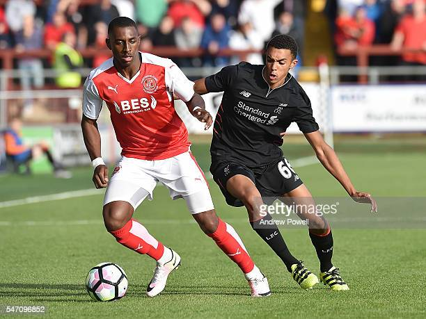 Trent AlexanderArnold of Liverpool competes with Amari'i Bell of Fleetwood Town during the PreSeason Friendly match bewteen Fleetwood Town and...