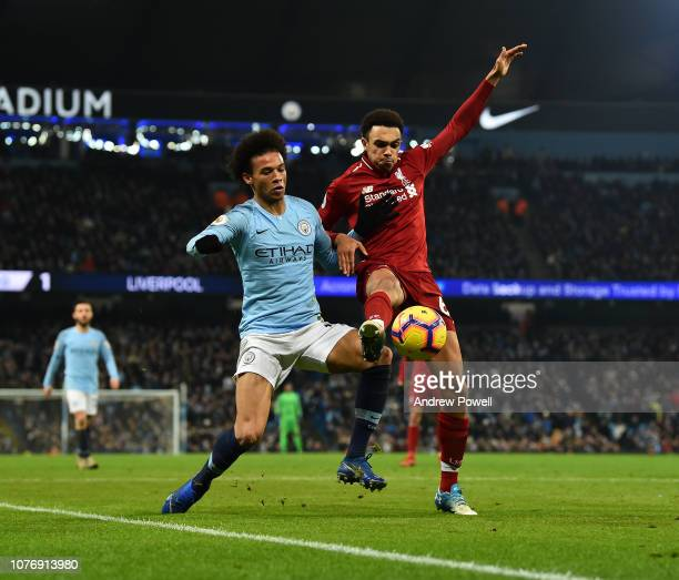 Trent AlexanderArnold of Liverpool competes with Leroy Sane of Manchester City during the Premier League match between Manchester City and Liverpool...