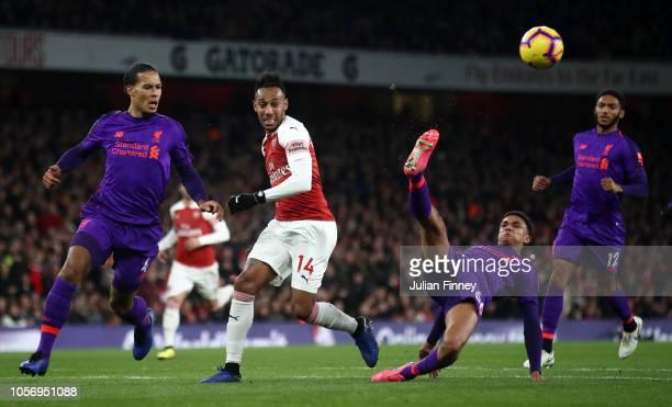 Trent AlexanderArnold of Liverpool controls the ball as Virgil van Dijk of Liverpool PierreEmerick Aubameyang of Arsenal and Joe Gomez of Liverpool...