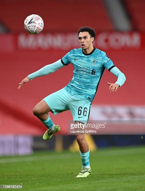 Trent Alexander-Arnold of Liverpool controls the ball during The Emirates FA Cup 4th Round match between Manchester United and Liverpool at Old...