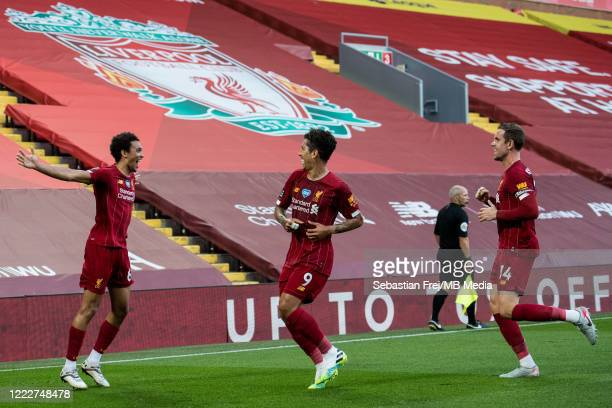 Trent Alexander-Arnold of Liverpool FC celebrate with hes team mates Roberto Firmino and Jordan Henderson after scoring 1st goal during the Premier...