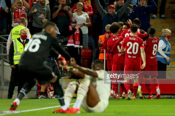 Trent Alexander-Arnold of Liverpool FC celebrates after scoring his team's first goal with teammates during the UEFA Champions League group B match...