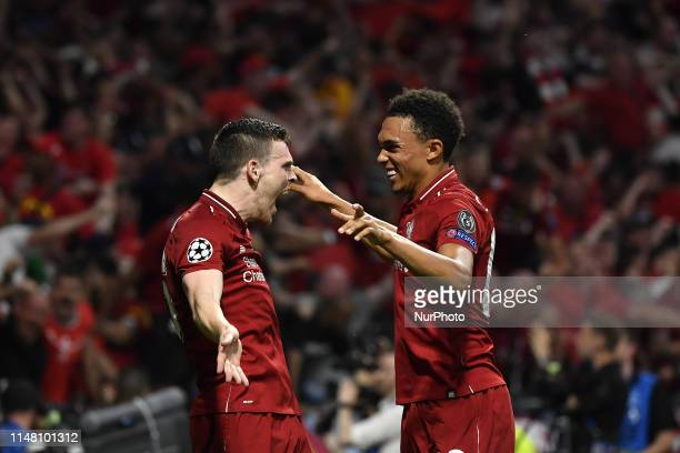 Trent AlexanderArnold of Liverpool FC celebrates with Andrew Robertson of Liverpool FC after Divock Origi of Liverpool FC scored second goal during...