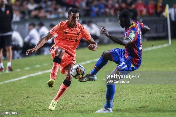 Trent AlexanderArnold of Liverpool FC competes for the ball against Jeffrey Schulpp of Crystal Palace during a 2017 Premier League Asia Trophy...