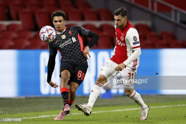 AMSTERDAM Trent AlexanderArnold of Liverpool FC Nico Tagliafico or Ajax during the UEFA Champions League match in group D between Ajax Amsterdam and...