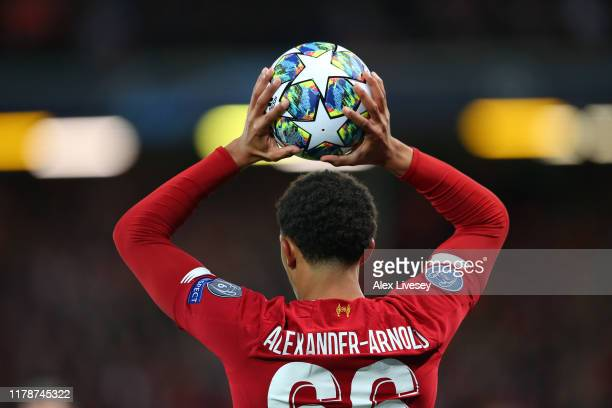 Trent AlexanderArnold of Liverpool FC takes a throw in during the UEFA Champions League group E match between Liverpool FC and RB Salzburg at Anfield...
