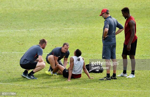 Trent AlexanderArnold of Liverpool gets treatment off Andy Renshaw Head of Physiotherapy and Andrew Massey Head of medical services as Jurgen Klopp...