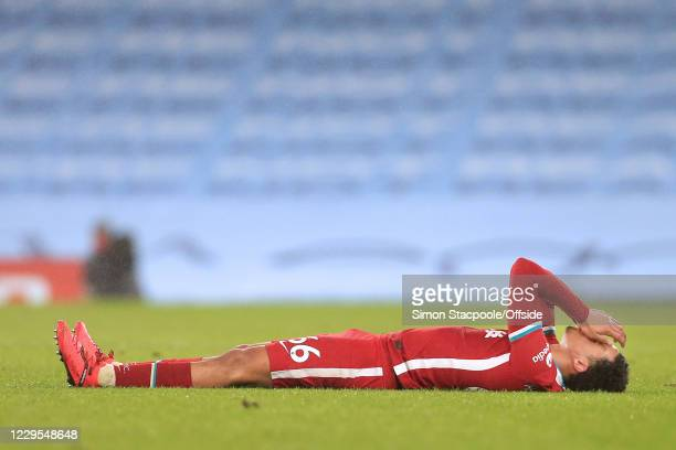 Trent Alexander-Arnold of Liverpool goes down injured during the Premier League match between Manchester City and Liverpool at Etihad Stadium on...