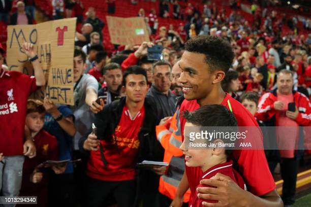 Trent AlexanderArnold of Liverpool has a photo with a young fan during the preseason friendly between Liverpool and Torino at Anfield on August 7...