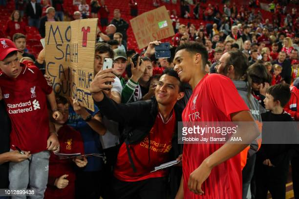 Trent AlexanderArnold of Liverpool has a selfie with a fan during the preseason friendly between Liverpool and Torino at Anfield on August 7 2018 in...