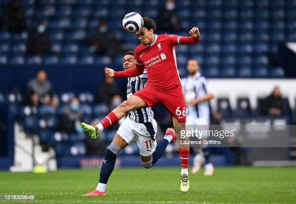 Trent Alexander-Arnold of Liverpool heads the ball whilst under pressure from Grady Diangana of West Bromwich Albion during the Premier League match...