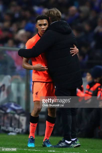 Trent AlexanderArnold of Liverpool hugs Manager of Liverpool Jurgen Klopp after being substituted during the UEFA Champions League Round of 16 First...