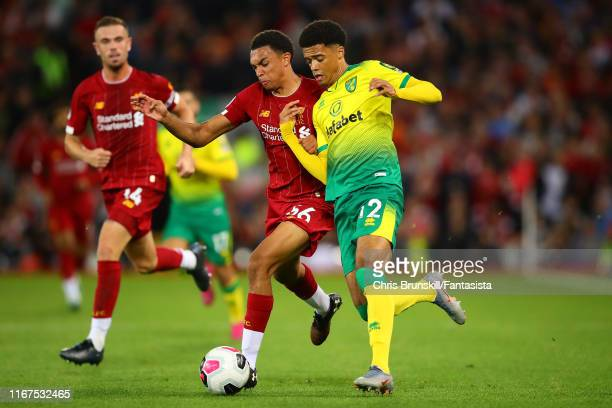 Trent Alexander-Arnold of Liverpool in action with Jamal Lewis of Norwich City during the Premier League match between Liverpool FC and Norwich City...