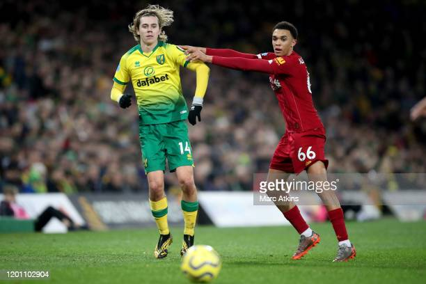 Trent AlexanderArnold of Liverpool in action with Todd Cantwell of Norwich City during the Premier League match between Norwich City and Liverpool FC...