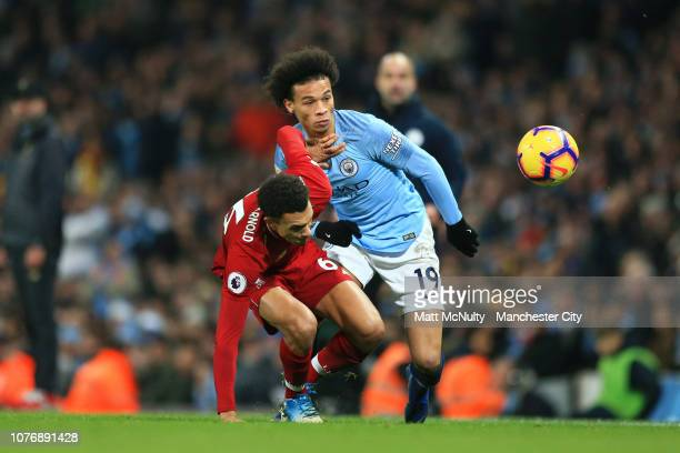 Trent AlexanderArnold of Liverpool is challenged by Leroy Sane of Manchester City during the Premier League match between Manchester City and...