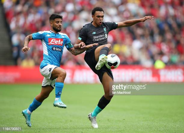 Trent AlexanderArnold of Liverpool is challenged by Lorenzo Insigne of SSC Napoli during the PreSeason Friendly match between Liverpool FC and SSC...