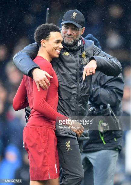 Trent AlexanderArnold of Liverpool is embraces by Jurgen Klopp Manager of Liverpool during the Premier League match between Fulham FC and Liverpool...
