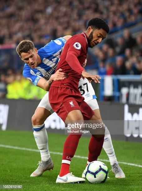 Trent AlexanderArnold of liverpool is tackled by Erik Durm of Huddersfield Town during the Premier League match between Huddersfield Town and...