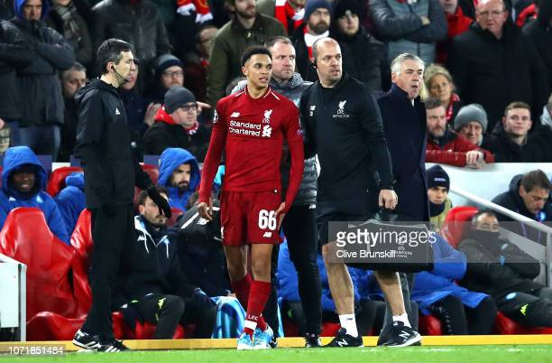 Trent AlexanderArnold of Liverpool looks on as he is given treatment during the UEFA Champions League Group C match between Liverpool and SSC Napoli...