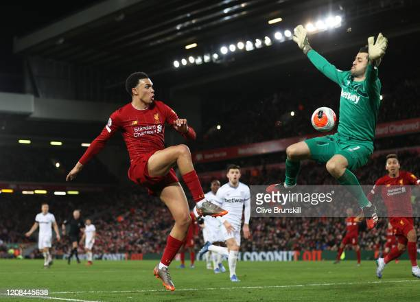Trent Alexander-Arnold of Liverpool passes the ball past Łukasz Fabiański of West Ham United for Sadio Mané of Liverpool to scores his sides third...