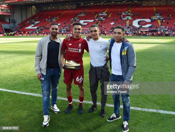Trent AlexanderArnold of Liverpool poses for a photograph with his brothers at the end of the Premier League match between Liverpool and Brighton and...