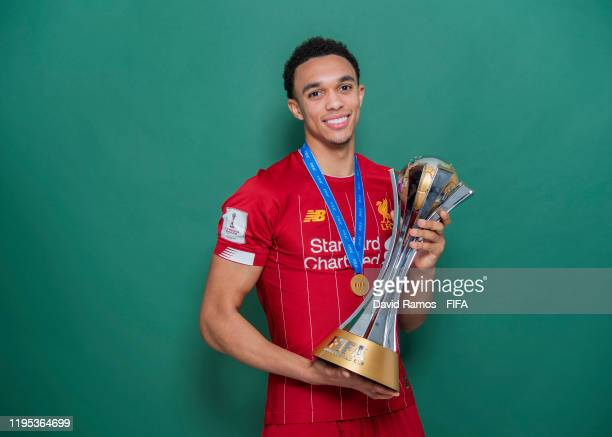 Trent AlexanderArnold of Liverpool poses with the Club World Cup trophy after the FIFA Club World Cup Qatar 2019 Final match between Liverpool and CR...