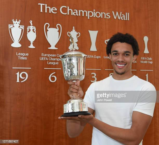 Trent Alexander-Arnold of Liverpool poses with the PFA Young Player of the Year Award at Melwood training ground on September 09, 2020 in Liverpool,...