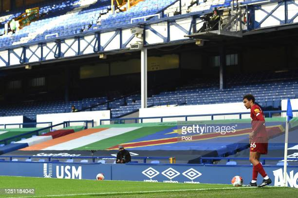 Trent Alexander-Arnold of Liverpool prepares to take a corner kick during the Premier League match between Everton FC and Liverpool FC at Goodison...