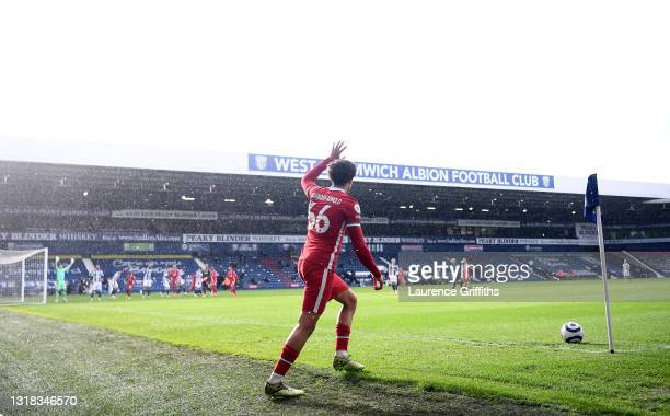 Trent Alexander-Arnold of Liverpool prepares to take a corner to set up the winning goal during the Premier League match between West Bromwich Albion...