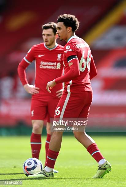Trent Alexander-Arnold of Liverpool prepares to take a free kick as Andrew Robertson looks on during the Premier League match between Liverpool and...