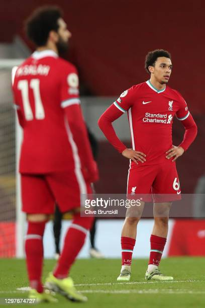 Trent Alexander-Arnold of Liverpool reacts after Ashley Barnes of Burnley scores their side's first goal from the penalty spot during the Premier...