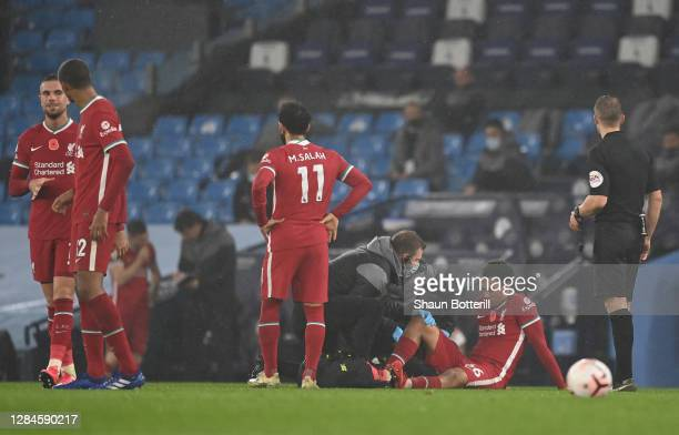 Trent Alexander-Arnold of Liverpool receives medical treatment during the Premier League match between Manchester City and Liverpool at Etihad...