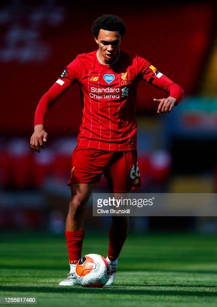 Trent AlexanderArnold of Liverpool runs with the ball during the Premier League match between Liverpool FC and Burnley FC at Anfield on July 11 2020...