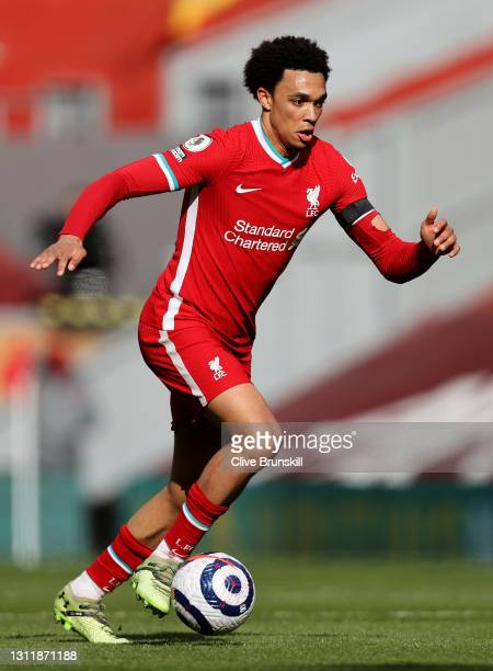 Trent Alexander-Arnold of Liverpool runs with the ball during the Premier League match between Liverpool and Aston Villa at Anfield on April 10, 2021...