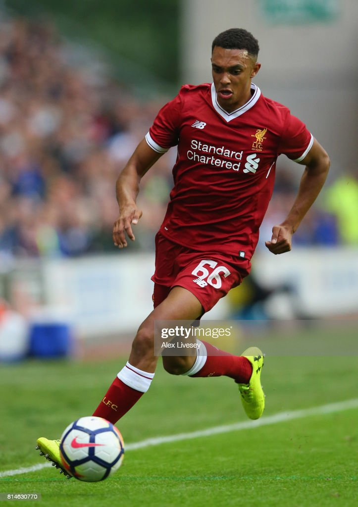 Trent Alexander-Arnold of Liverpool runs with the ball during the pre-season friendly match between Wigan Athletic and Liverpool at DW Stadium on July 14, 2017 in Wigan, England.
