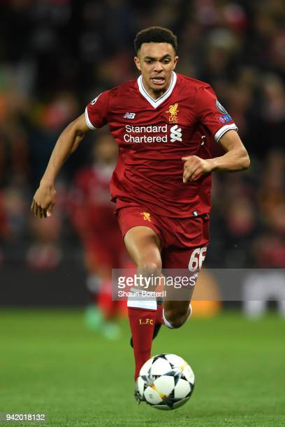 Trent AlexanderArnold of Liverpool runs with the ball during the UEFA Champions League Quarter Final Leg One match between Liverpool and Manchester...