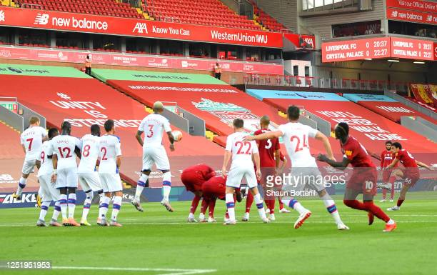 Trent AlexanderArnold of Liverpool scores his teams first goal from a free kick during the Premier League match between Liverpool FC and Crystal...