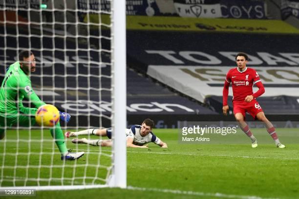Trent Alexander-Arnold of Liverpool scores his team's second goal past Hugo Lloris of Tottenham Hotspur during the Premier League match between...