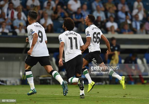 Trent AlexanderArnold of Liverpool Scores The Opener and celebrates during the UEFA Champions League Qualifying PlayOffs Round First Leg match...