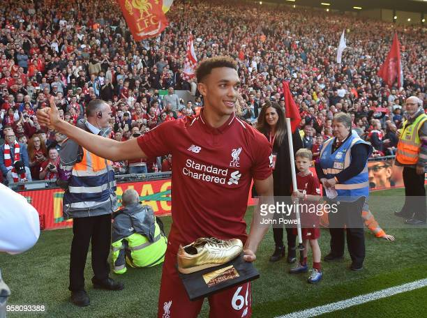 Trent AlexanderArnold of Liverpool shows his appreciation to the fans at the end of the Premier League match between Liverpool and Brighton and Hove...
