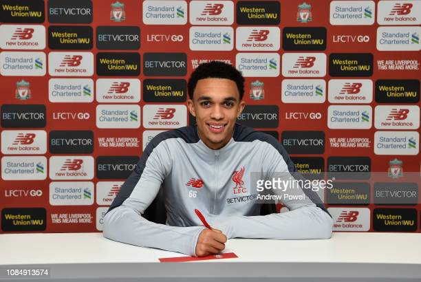 Trent AlexanderArnold of Liverpool signing a contract extension at Anfield on January 18 2019 in Liverpool England