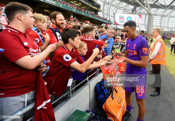 Trent AlexanderArnold of Liverpool signing autographs and taking selfie at the end of the end of the pre season friendly match between Liverpool and...