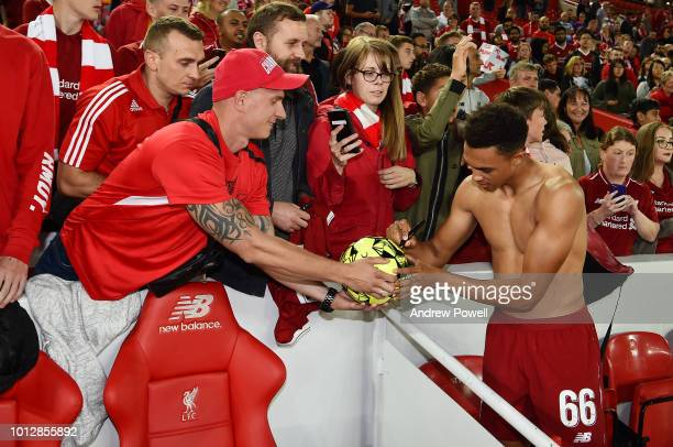 Trent AlexanderArnold of Liverpool signing autographs and taking selfies at the end of the PreSeason friendly match between Liverpool and Torino at...