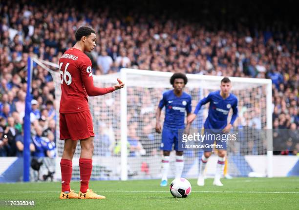 Trent AlexanderArnold of Liverpool stands over a set piece during the Premier League match between Chelsea FC and Liverpool FC at Stamford Bridge on...